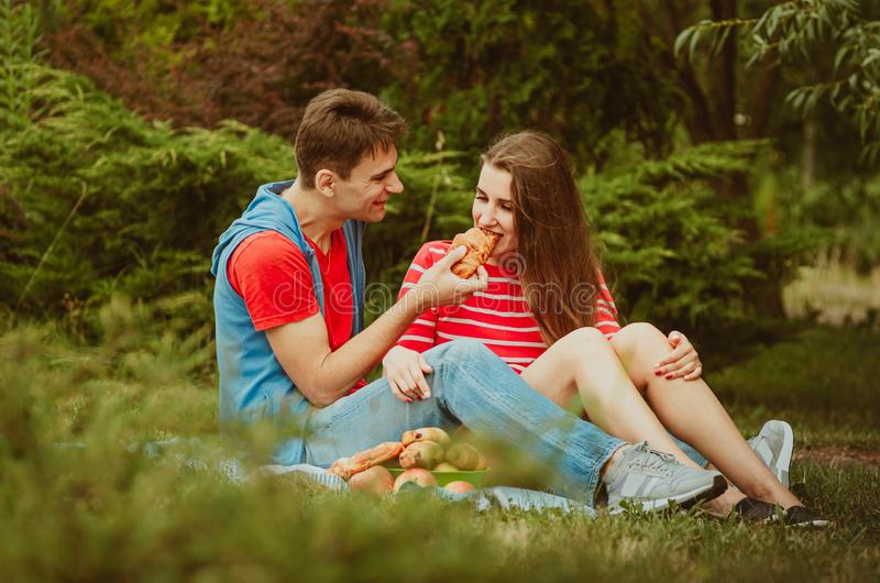 Beautiful young couple in love decided to have a romantic picnic in the park. A date, time spent together is priceless. Camping in stock images
