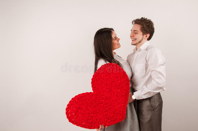 Beautiful young couple. Beautiful young love couple embracing against white background stock photo