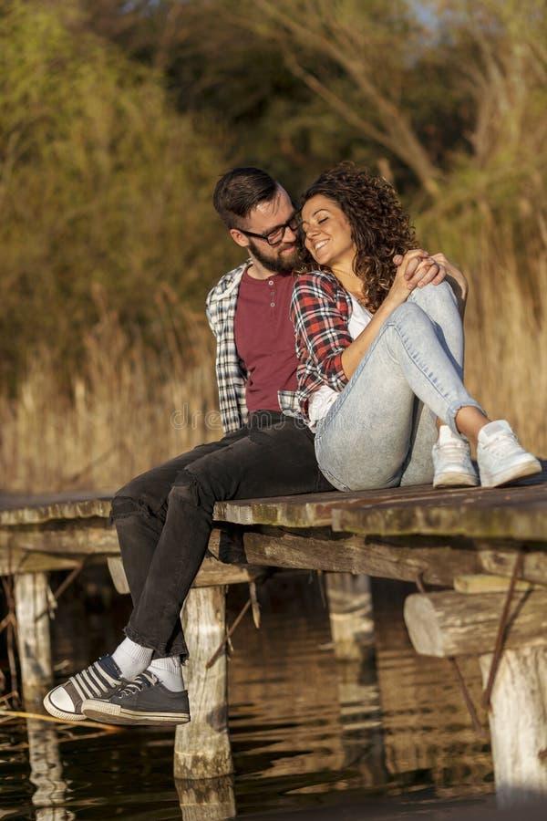 Couple hugging at the lake docks royalty free stock photos