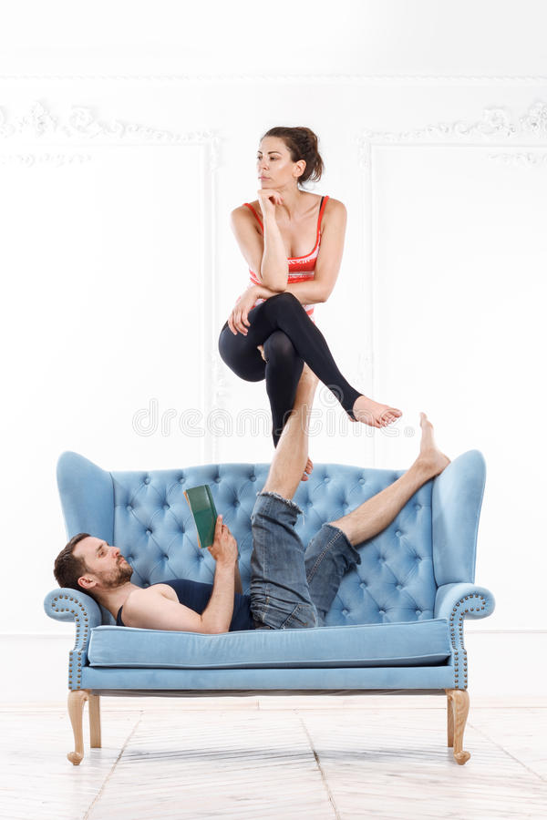 Beautiful Young Couple Practicing Acro-Yoga royalty free stock photography