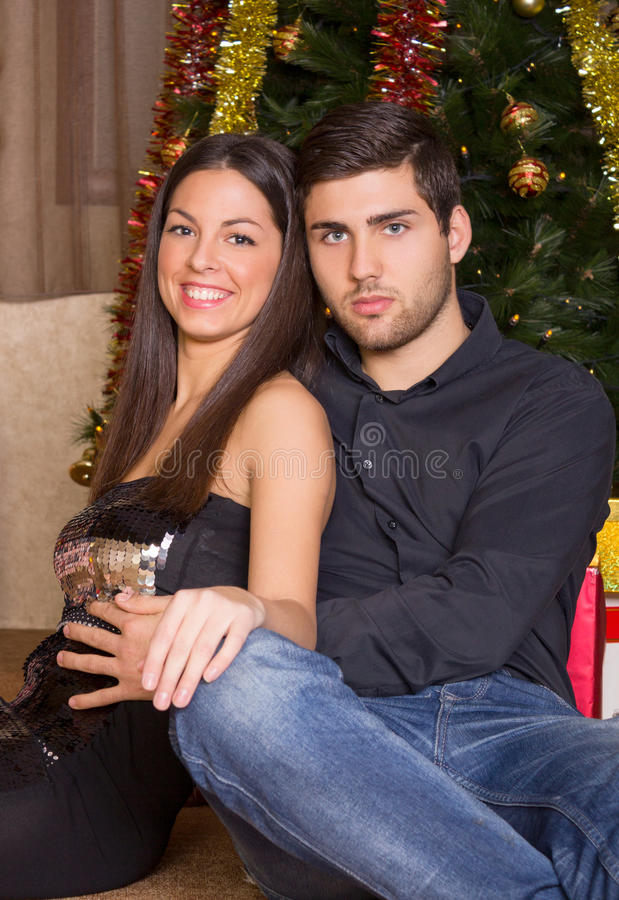 Beautiful young couple in romantic Christmas night royalty free stock photo