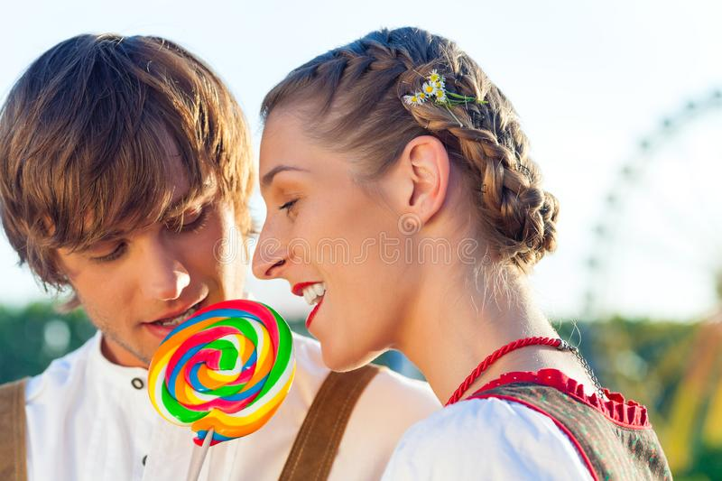 Beautiful young couple sharing lollipop stock images