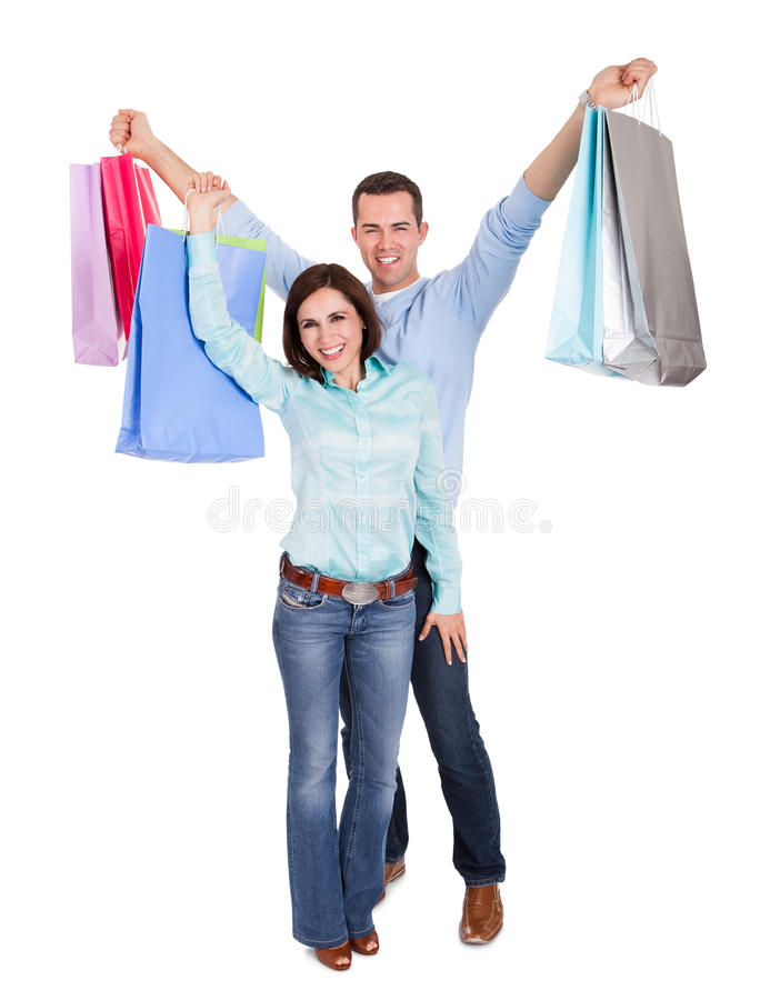 Download Beautiful Young Couple With Shopping Bags Stock Image - Image: 25760455