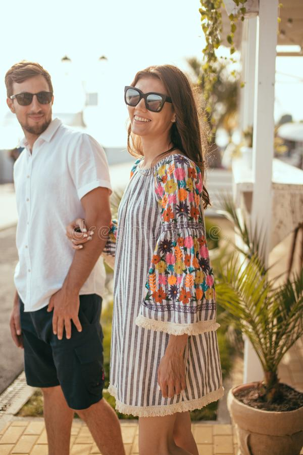 The beautiful young couple smiling together outdoor royalty free stock photos