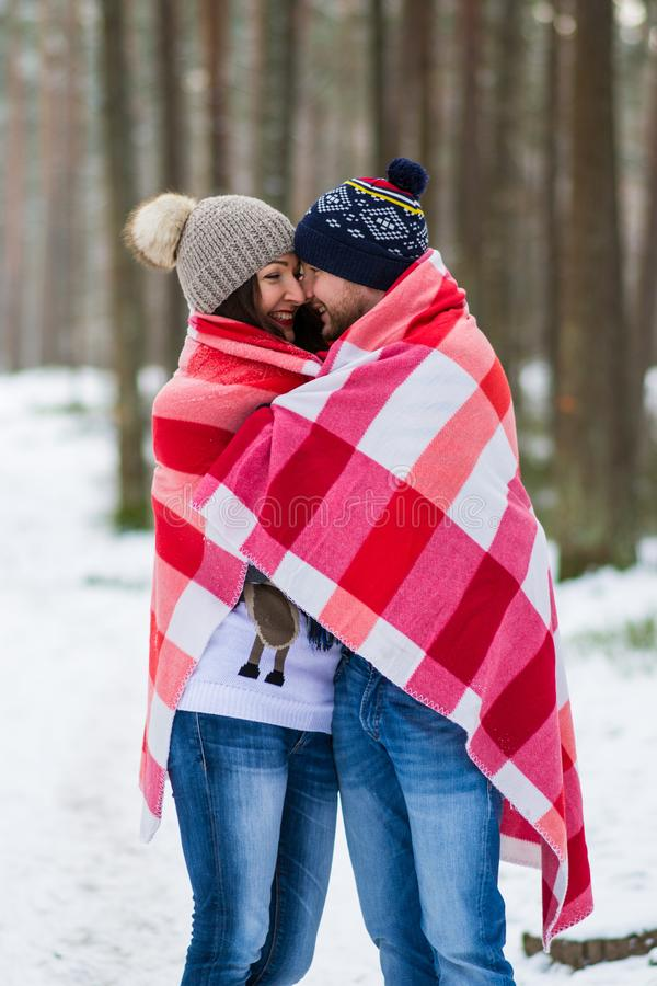 Beautiful Young Couple Walking in Snowy Winter Forest Embrace. Happy Valentines Day Outdoor royalty free stock images