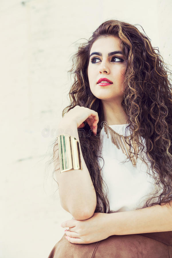 Beautiful young curly hair woman. Elegant and charming girl. royalty free stock image