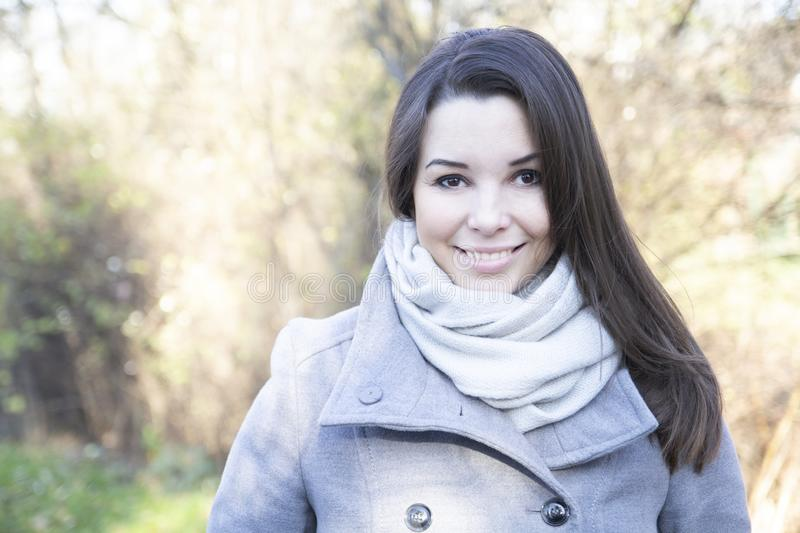 Portrait of smiling woman in an autumn park royalty free stock photography