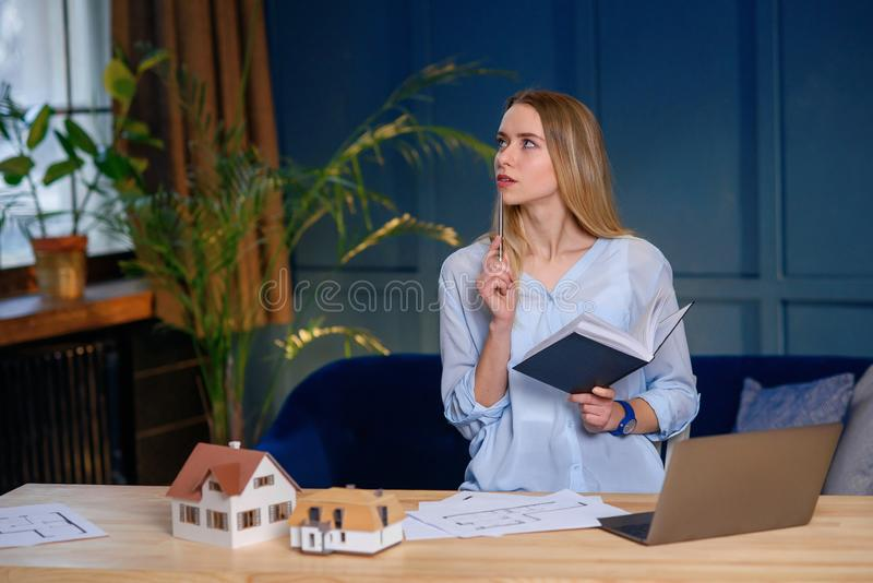 Beautiful young designer, architect during work day in the office. royalty free stock photos