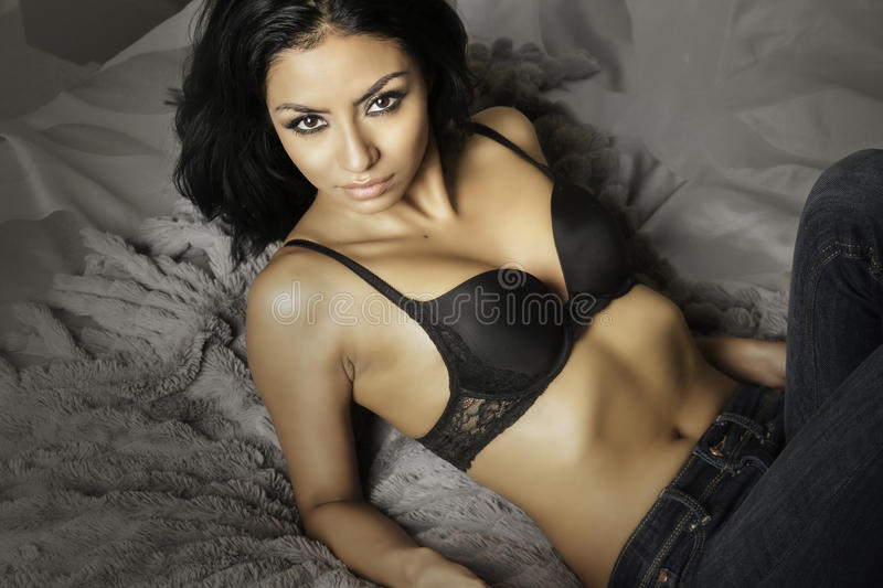 Beautiful young exotic woman holding gun stock images