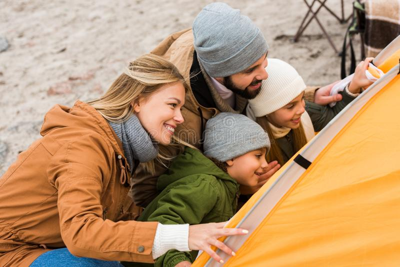Beautiful young family looking. At camping tent stock photo