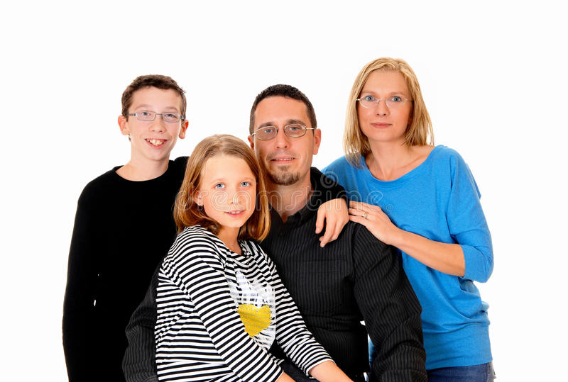 Beautiful young family. A picture of a young family with a daughter and son standing isolated for white background stock photo