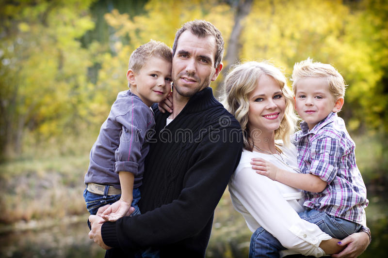 Beautiful Young Family Portrait with Fall colors royalty free stock photos