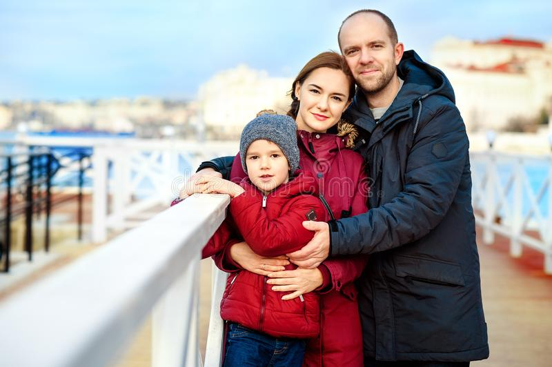 Beautiful Young Family Portrait on the quay near the sea royalty free stock photo