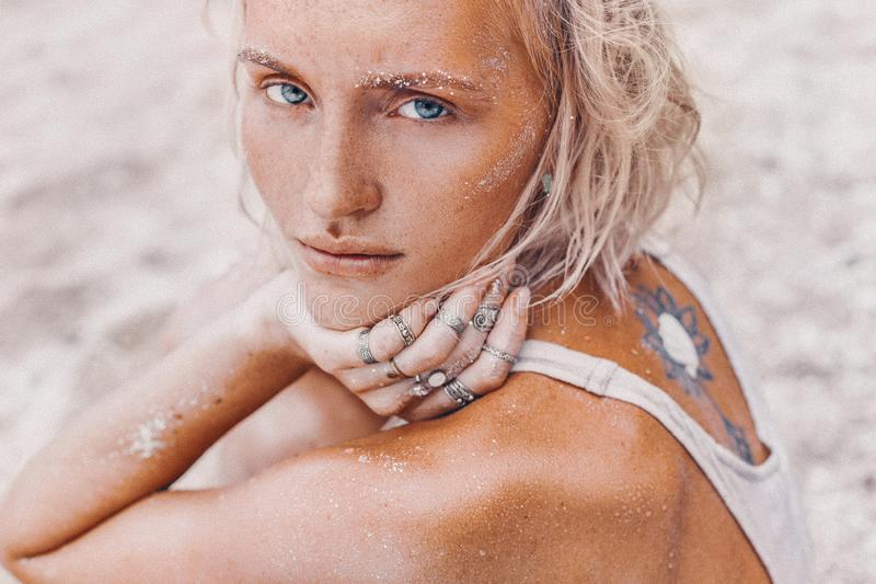 Beautiful young fashion model on the beach. Close up portrait of boho model stock images