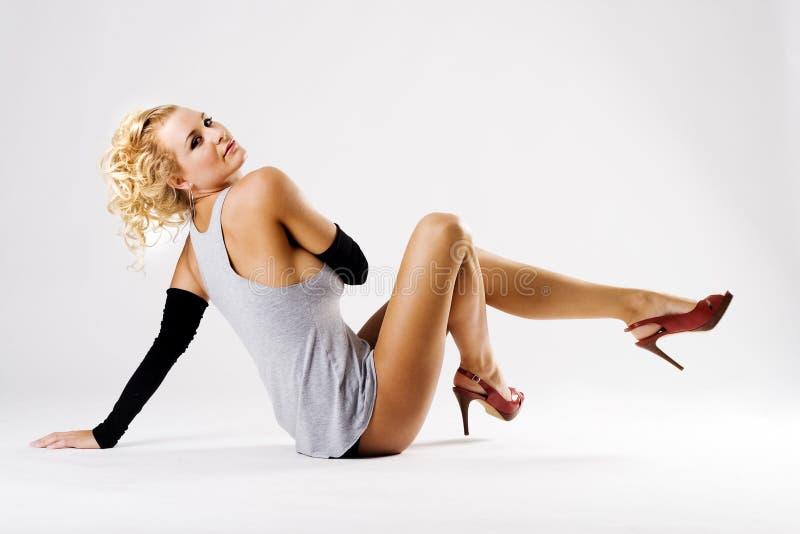 Beautiful young fashion model with long legs