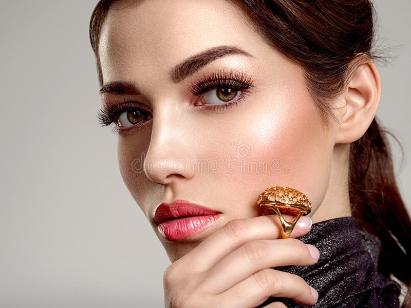 Beautiful young fashion woman with living coral lipstick. Attractive white girl wears luxury jewelry stock images