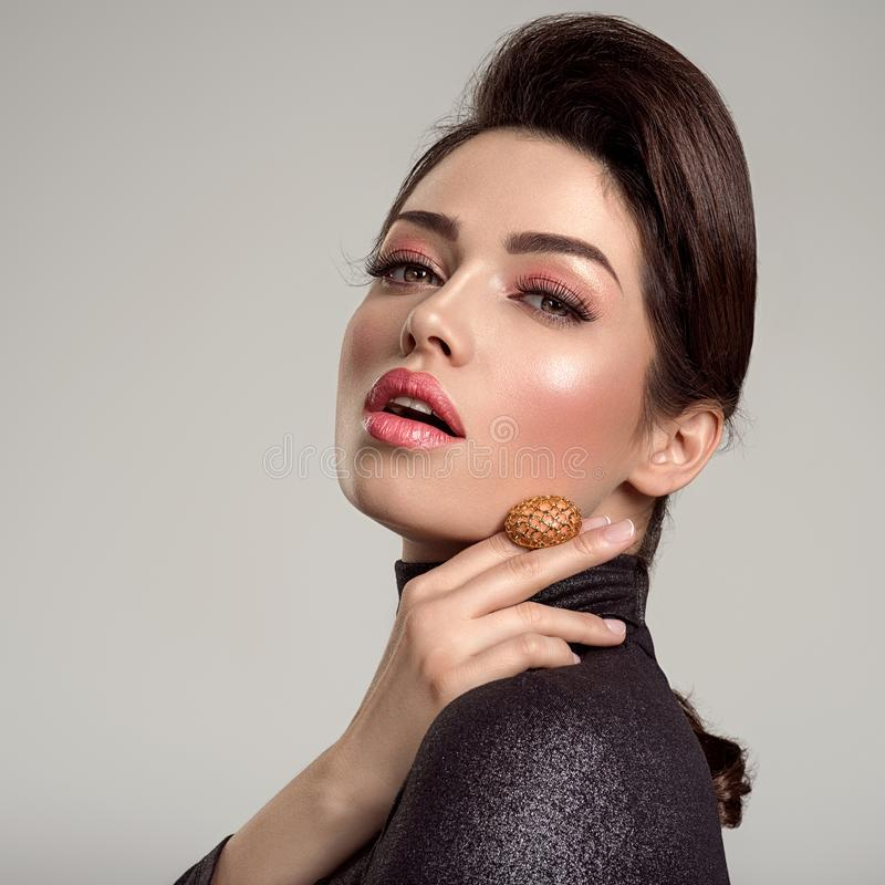 Beautiful young fashion woman with living coral lipstick. Attractive white girl wears luxury jewelry stock photo
