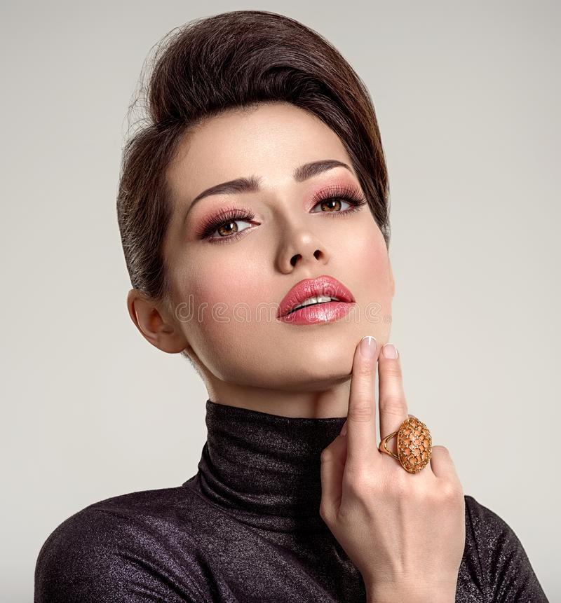 Beautiful young fashion woman with living coral lipstick. Attractive white girl wears luxury jewelry stock image