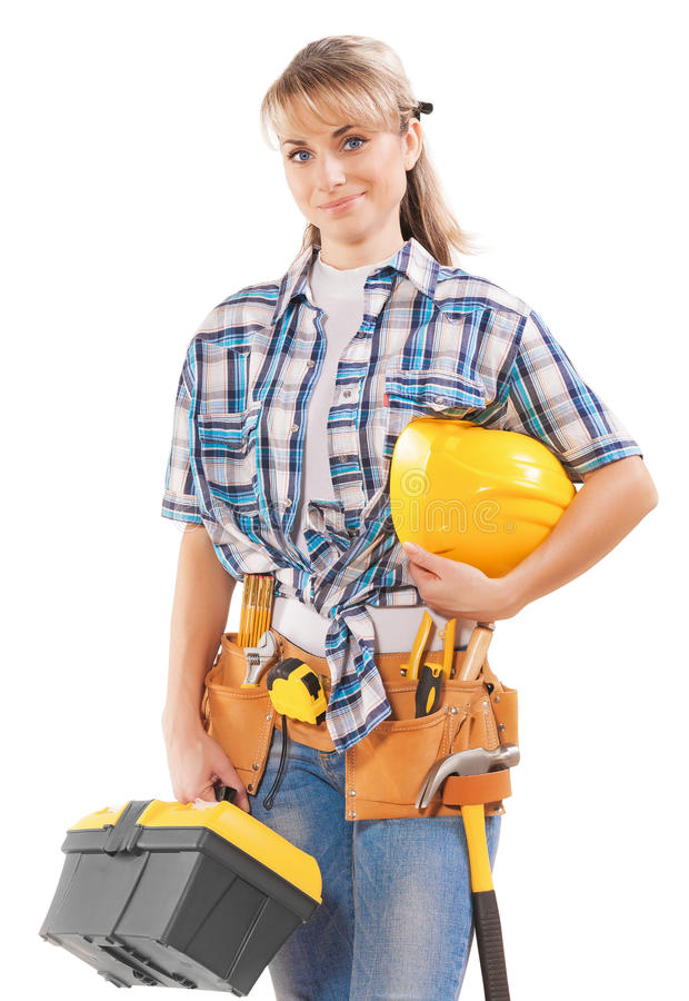 beautiful young female construction contractor with tools isolated on white background stock photography