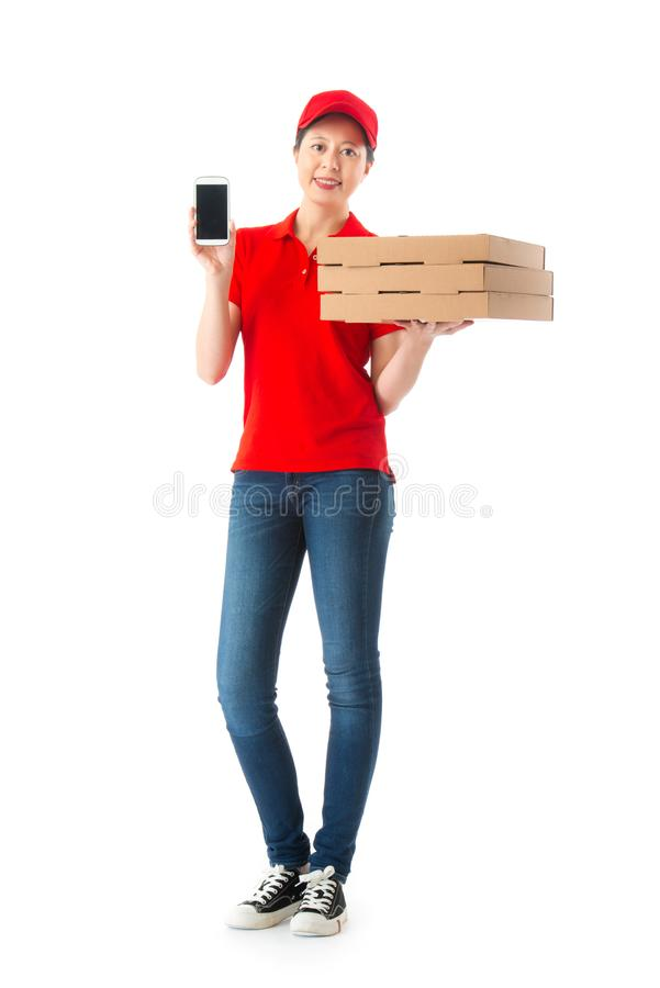 Beautiful young female delivery worker holding box stock image
