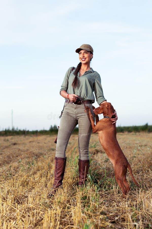 Beautiful female hunter with furry companion. royalty free stock photo