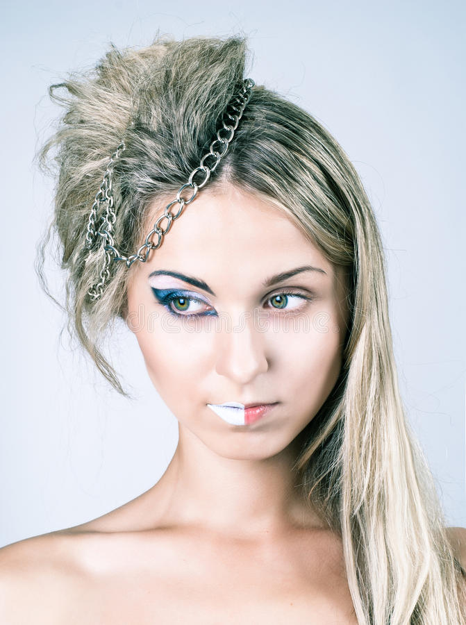 Beautiful Young Female With Impudent Make Up Stock Photos