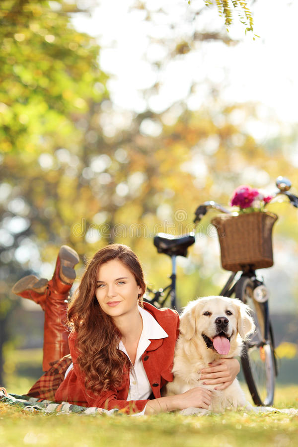 Download Beautiful Young Female Lying Down With Dog In A Park Stock Photo - Image: 34786968