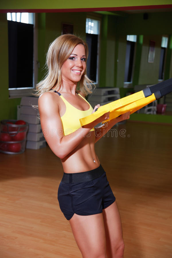 Beautiful young fitnes model working out royalty free stock photography