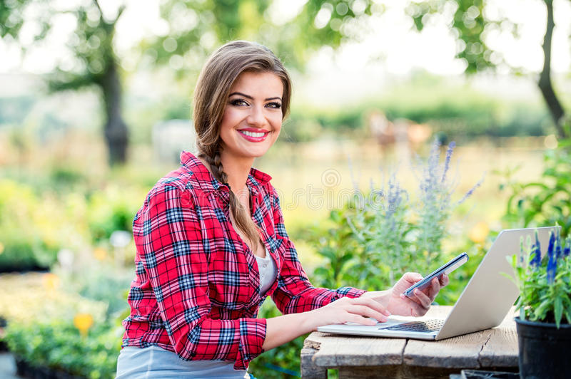 Beautiful young garden manager stock image