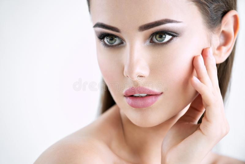 Beautiful young girl with beauty face stock photography