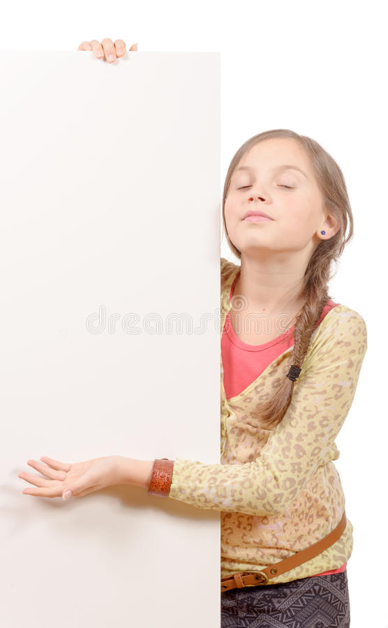Beautiful young girl with a blank poster isolated on white back. A beautiful young girl with a blank poster isolated on white background stock photos