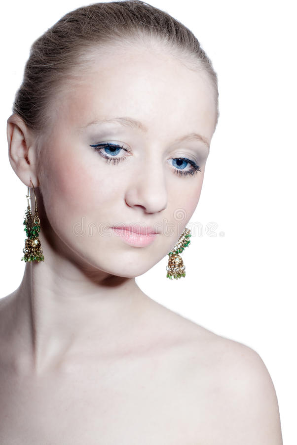 Beautiful young girl with blue eyes, isolated stock photo