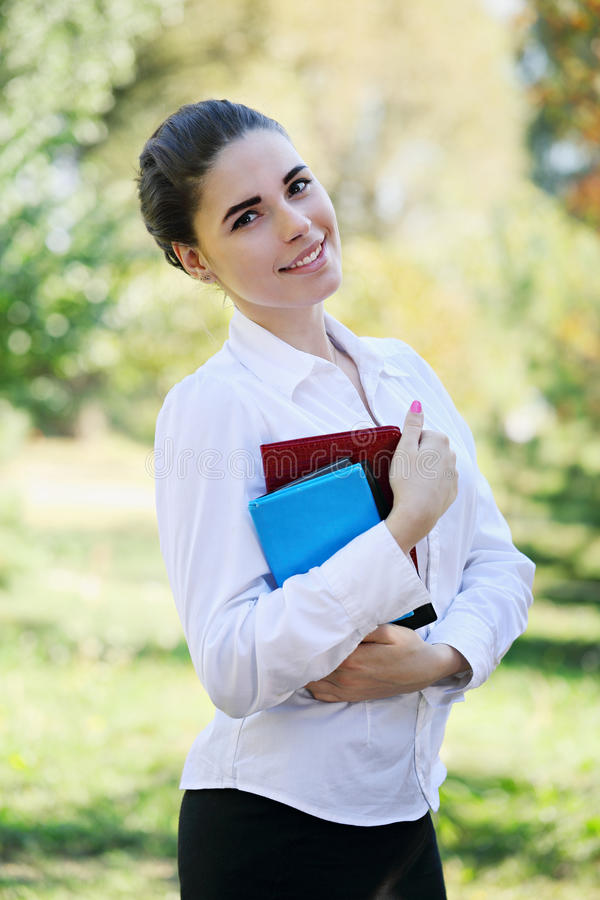 Beautiful young girl with books royalty free stock image