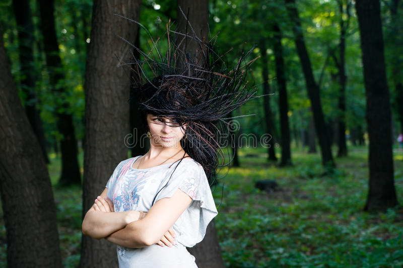 Beautiful young girl with braids in park royalty free stock image