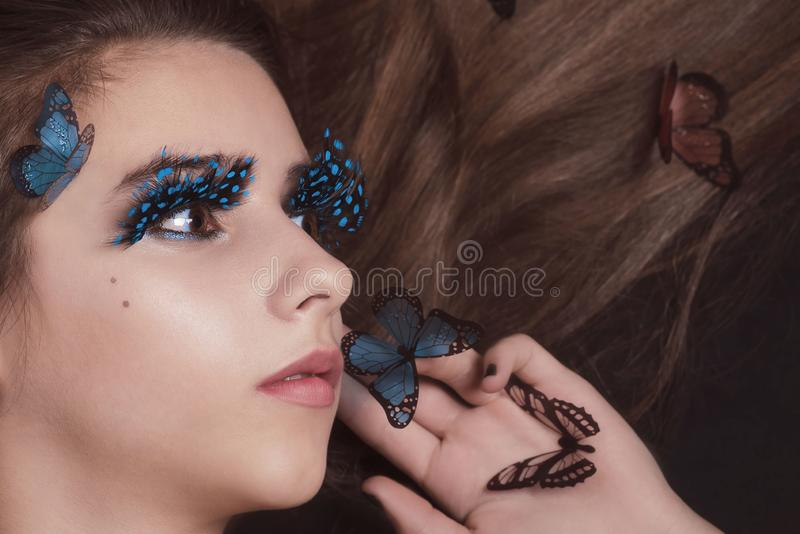 Beautiful young girl with butterflies in her hair. Fashion and beauti photo.Fashion studio photo of young beauty woman stock images