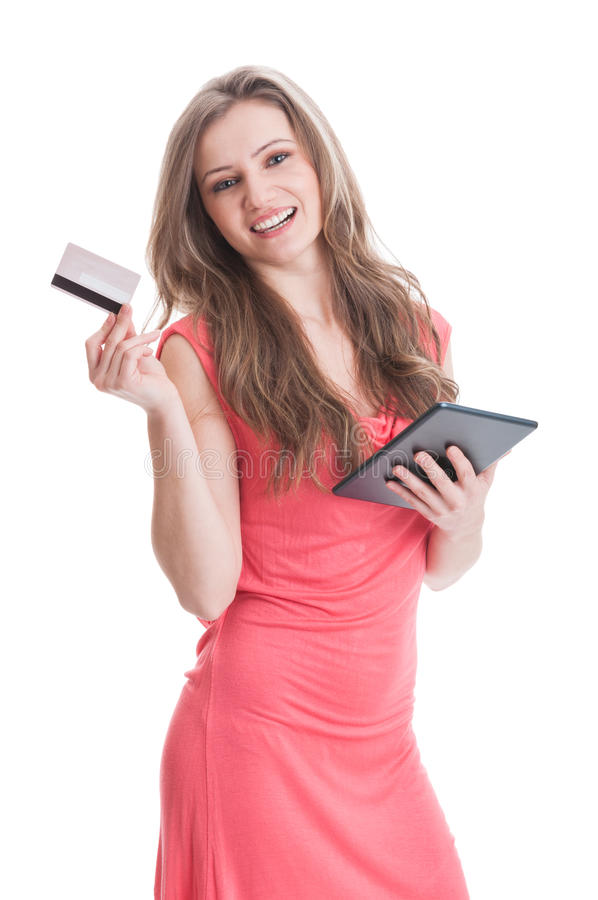 Beautiful and young girl buying online using card stock photography