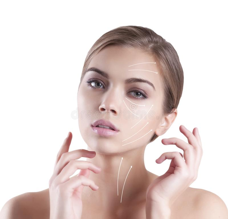 Beautiful young girl clean face arrow natural concept, lifting stock photos
