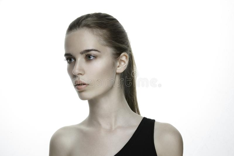 Beautiful young girl, clean soft skin care. Beauty Portrait. Perfect Fresh Skin. Youth and Skin Care Concept, pony tail. royalty free stock image