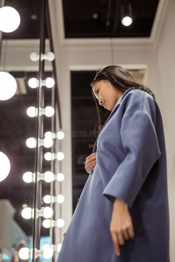 Beautiful young girl in a coat stock photos