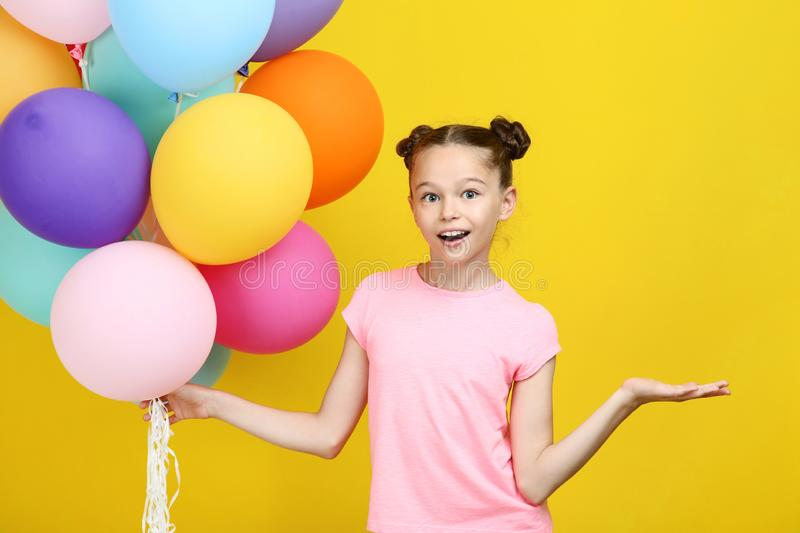Young girl with colored balloons royalty free stock images