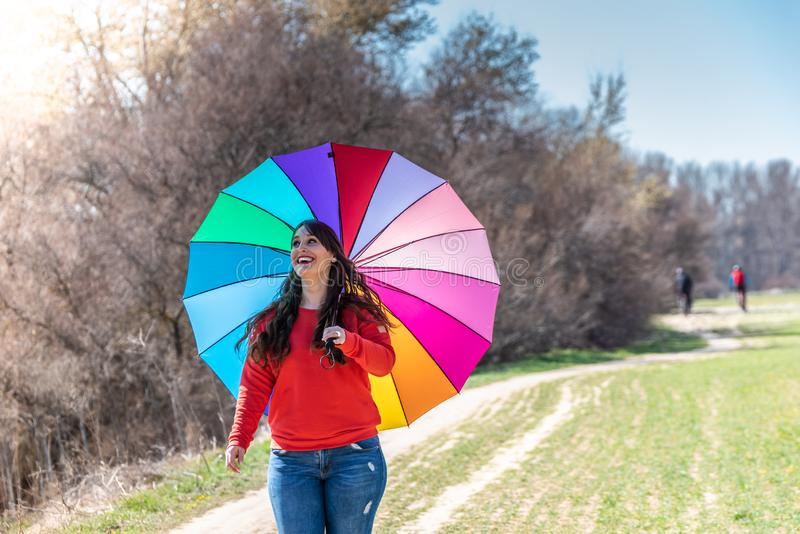 Young Woman Walking and Having Fun with an Umbrella royalty free stock photography