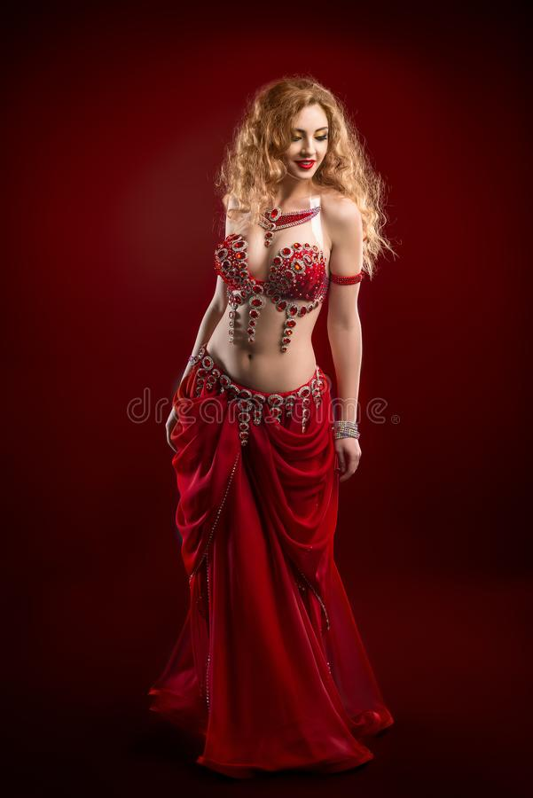 Belly dancer in red costume stock images