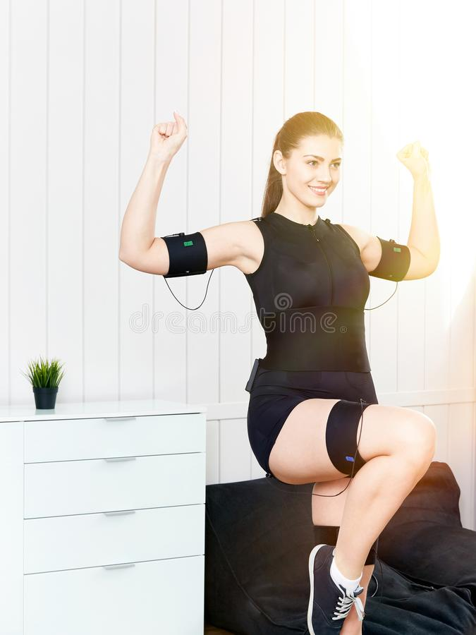 Young woman in an EMS workout. stock photo