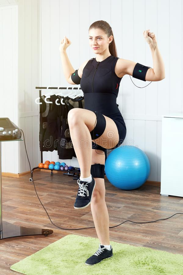 Young woman in an EMS workout. royalty free stock photo
