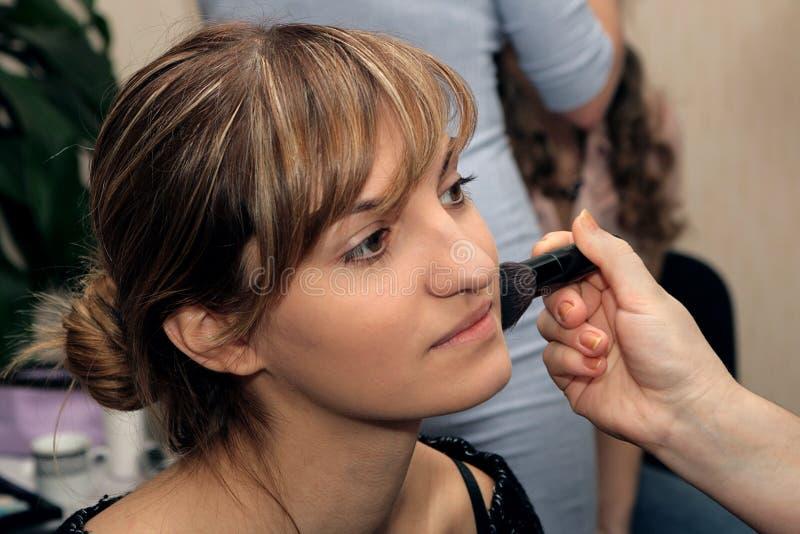 Beautiful Young Girl Doing Makeup Stock Photos