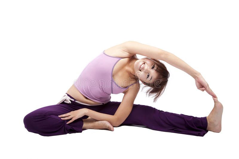 Beautiful young girl doing yoga royalty free stock photo