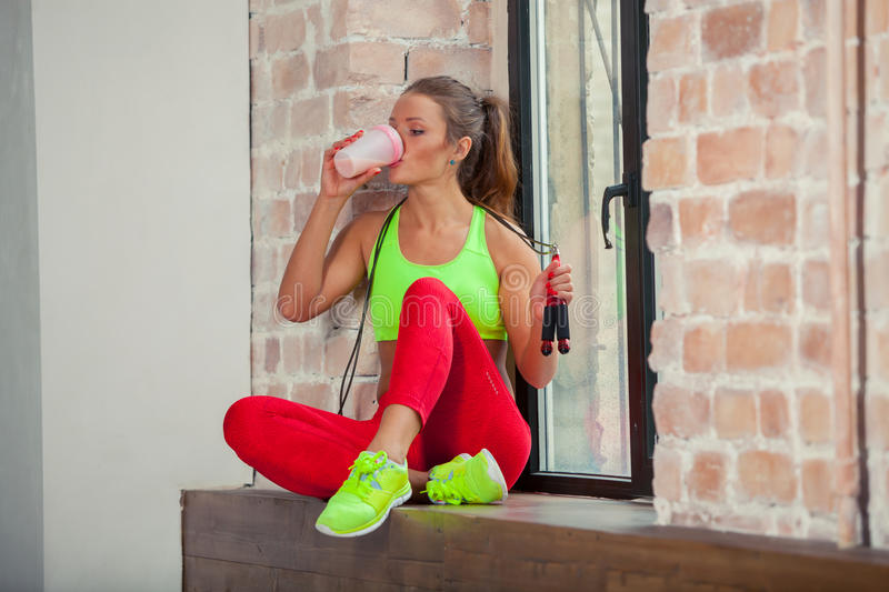 Beautiful young girl is drinking a fitness smoothie. Healthy lifestyles concept. stock images