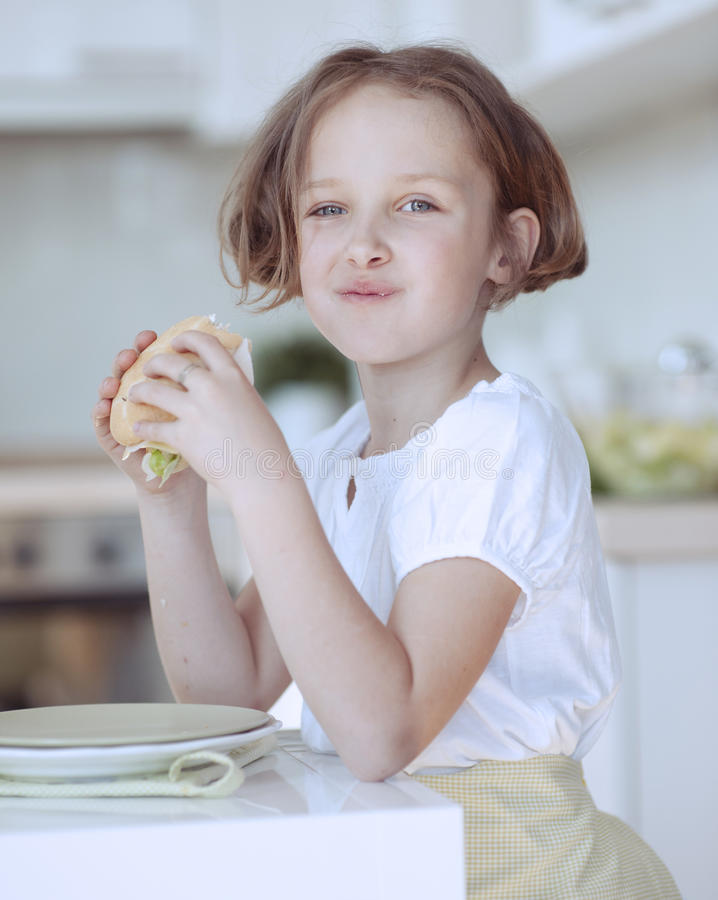 Beautiful Young Girl eating sandwich royalty free stock photos