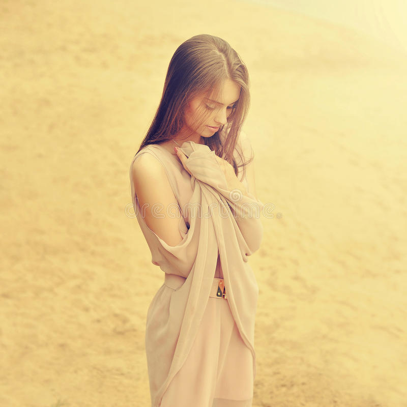 Beautiful young girl in elegant dress stock images