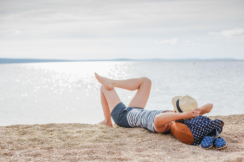 Beautiful young girl enjoying freedom at the beach. Freedom, happiness, enjoy stock photos